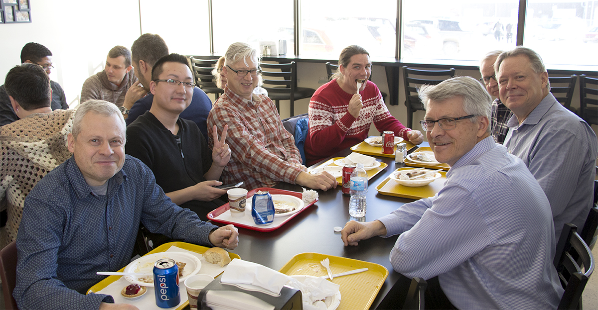 DeFehr Furniture employees enjoying Christmas dinner together image